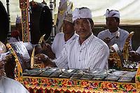 Jatiluwih, Bali, Indonesia.  Musician Playing a Metallophone in a Gamelan Orchestra,  Luhur Bhujangga Waisnawa Hindu Temple.