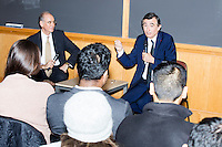 Philippe Douste-Blazy (right) speaks to a group of mostly Harvard graduate students during a lunch-time conversation with professor Rifat Atun (left) during a visit to Harvard University's T. H. Chan School of Public Health in Boston, Massachusetts, USA. Atun is the director of the Global Health Systems Cluster and a Professor of Global Health Systems at the School of Public Health. The visit is part of his campaign to become Director General of the World Health Organization. During the visit, he met with professors, students, and visiting scholars, including former Ministers of Health from England and Brazil. Doutse-Blazy is Under-Secretary-General and Special Adviser on Innovative Financing for Development in the United Nations and chairman of UNITAID. He served as Minister of Health, Minister of Culture, and Foreign Minister in the French government and was also mayor of Lourdes and Toulouse.