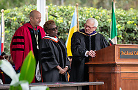 Conferring of Honorary Degree and Response - Jonathan Veitch, President, Olamide U. Ajose '87<br /> Senior Policy Adviser for Higher Education for Governor Gavin Newsom and Dennis Collins p'94 Trustee Emeritus.<br /> Families, friends, faculty, staff and distinguished guests celebrate the class of 2019 during Occidental College's 137th Commencement ceremony on Sunday, May 19, 2019 in the Remsen Bird Hillside Theater.<br /> (Photo by Marc Campos, Occidental College Photographer)