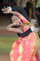 Hu Fu and Ying Ying Xiang from China perform their dance during the Professional Latin competition of the Blackpool Dance Festival that is the most famous event among dance competitions held in Blackpool, United Kingdom on June 01, 2011. ATTILA VOLGYI