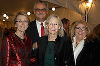 NWA Democrat-Gazette/CARIN SCHOPPMEYER Lynne Walton, The Peel Compton Foundation president (from left), David Atwood, Melba Shewmaker and Janet Atwood visit at the foundation's annual Christmas gala Dec. 10 at the Peel Mansion in Bentonville.