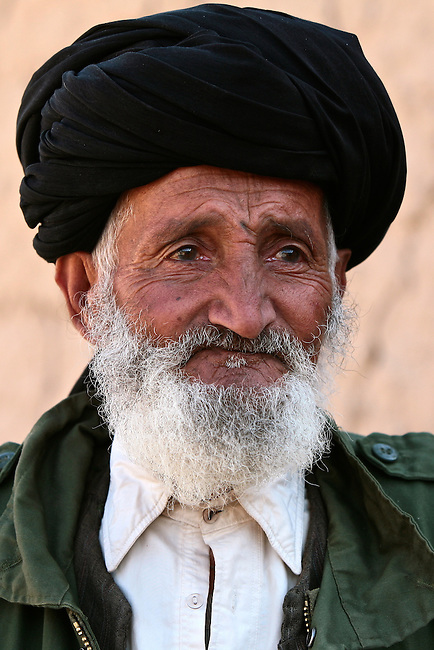 An Afghan elder watches silently as U.S. and Afghan troops search his family's compound in the Shah Joy district of southern Afghanistan's Zabul province. Oct. 25, 2009. DREW BROWN/STARS AND STRIPES