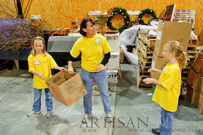 Outrageous Outreach and their families volunteer at Backpacks of food for Guilford County Schools an Out of the Garden Project as part of Westminster Presbyterian Church's One Great Weekend of Service on Sunday November 6, 2011. Westminster volunteers helped with many tasks such as, cleaning, sorting can foods, stock shelves, packing rice and packing food bags. (Chris English/Artisan Image © 2011)