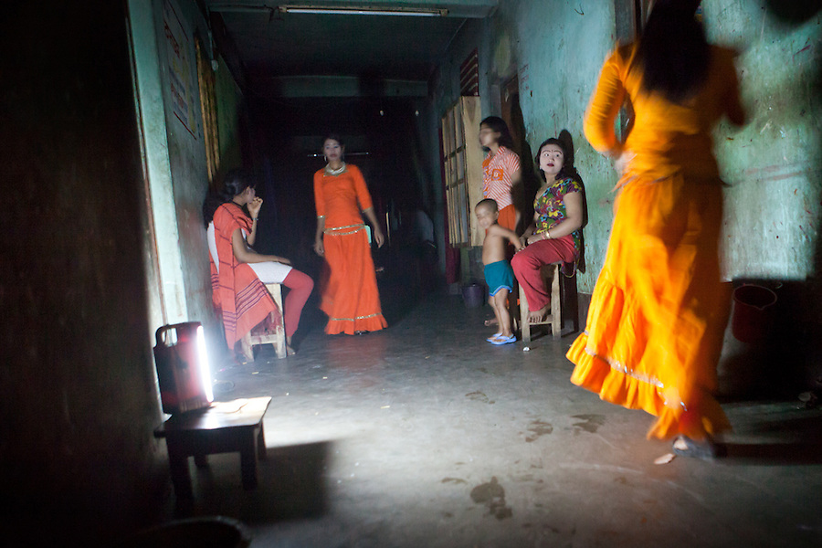 "Faridpur Brothel is the second to largest brothel in Bangladesh. (17 registered brothels in the country) 600+ girls live in a hidden neighboorhood accesible through one of the six alleyways, covered with small ragged curtains mimicking doors. Many girls are under aged - the ""legal"" age being 18. The chhukris wait during long periods of time for clients to walk past their rooms, the girls are forced to stake out their territory 24h/7 365 days a year. Like many countries on earth, life still goes on seemlessly when the electricity gets cut off. March 13, 2011. Gabriela Barnuevo"