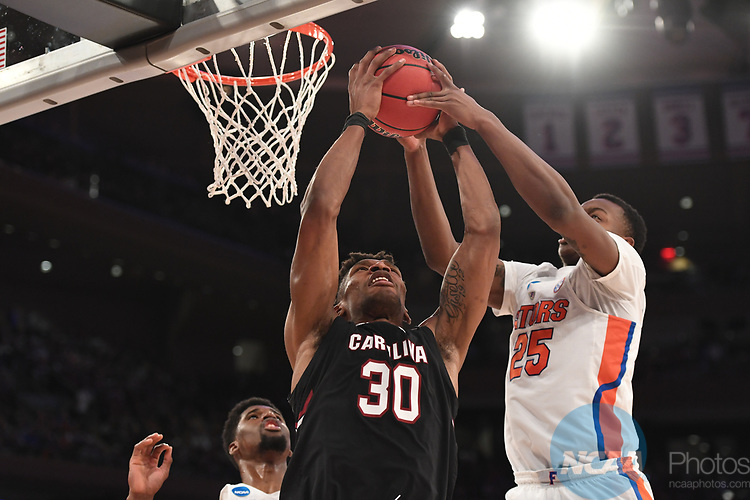 NEW YORK, NY - MARCH 26:  Chris Silva #30 of the South Carolina Gamecocks is guarded by Keith Stone #25 of the Florida Gators during the 2017 NCAA Men's Basketball Tournament held at Madison Square Garden on March 26, 2017 in New York City. (Photo by Justin Tafoya/NCAA Photos via Getty Images)