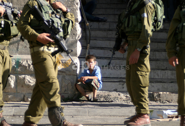 An Israeli soldiers patrol a streets in the West Bank city of Hebron on 30 July 2009.  Photo by Najeh Hashlamoun