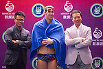 HAIKOU, CHINA - OCTOBER 30:  Multiple Olympic gold medalist Michael Phelps C() of USA poses with Tenniel Chu (R), Executive Director of Mission Hills Golf Club and  Dr. Ken Chu, Vice Chairman of Mission Hills Group during a promotional event on day four of the Mission Hills Start Trophy tournament at Mission Hills Resort on October 30, 2010 in Haikou, China. The Mission Hills Star Trophy is Asia's leading leisure liflestyle event and features Hollywood celebrities and international golf stars.  Photo by Victor Fraile / The Power of Sport Images