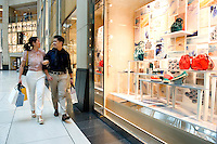 HONG KONG - MAY 04: Patricia Szeto and Jonathan Lui do some window shopping in Landmark shopping mall in Central business district, on May 4, in Hong Kong. (Photo by Lucas Schifres/Pictobank)