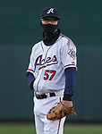 Aces second basemen Kelby Tomlinson (57) tries to say warm during the 2019 opening day game between the Reno Aces and the Albuquerque Isotopes at Greater Nevada Field in Reno, Nevada on Tuesday, April 9, 2019.