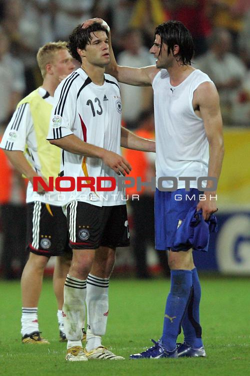 FIFA WM 2006 -  Semi Finals / Halbfinale<br /> Play    #61 (04-Juli) - Deutschland - Italien<br /> <br /> Trost von Vincenzo Iaquinta (rechts) von Italien f&uuml;r Michael Ballack (links) von Deutschland.<br /> <br /> Foto &copy; nordphoto