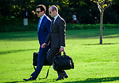 Deputy Assistant to the President for Operations and Personal Aide to the President Nicholas Luna, left and Senior Advisor for Policy Stephen Miller, right, walk across the South Lawn to accompany United States President Donald J. Trump as he prepares to depart the White House in Washington, DC to deliver remarks at a Keep America Great Rally in Minneapolis, Minnesota on Thursday, October 10, 2019.<br /> Credit: Ron Sachs / CNP