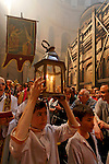 Israel, Jerusalem Old City, the Syrian Orthodox procession carrying the Holy Light after the Ceremony of the Holy Light at the Church of the Holy Sepulchre on Holy Saturday. Easter 2005<br />