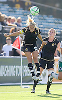 Leslie Osborne (10) jumps to head the ball as teammate Leigh Ann Robinson (7) looks on. St. Louis Athletica defeated FC Gold Pride 1-0 at Buck Shaw Stadium in Santa Clara, California on July 5, 2009.