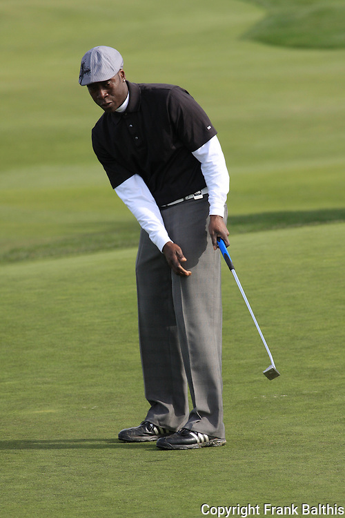 Don Cheadle putting at Monterey Peninsula Country Club