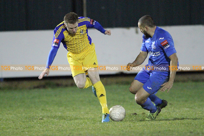 Danny Jones of Romford challenged by Aaron Scott of Redbridge - Redbridge vs Romford - Ryman League Division One North Football at Oakside Stadium, Barkingside - 03/03/15 - MANDATORY CREDIT: Mick Kearns/TGSPHOTO - Self billing applies where appropriate - contact@tgsphoto.co.uk - NO UNPAID USE