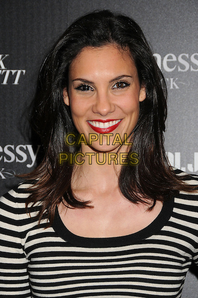 Daniela Ruah.Hennessy Toasts Achievements in Music with Grammy Host LL Cool J and Mark Burnett held at the SLS Hotel, Los Angeles, California, USA, .9th February 2013..portrait headshot red lipstick  black and white striped smiling .CAP/ADM/BP.©Byron Purvis/AdMedia/Capital Pictures.