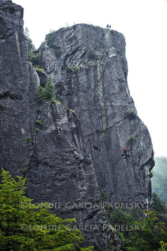 Rappeling Tower of the Winds in the rain, Cave Camp, Futalefu River, Los Lagos Region, Patagonia, Chile, South America
