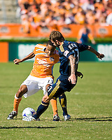 Los Angeles Galaxy midfielder David Beckham (23) attempts to strike the ball away from Houston Dynamo midfielder Ricardo Clark (13). Houston Dynamo tied Los Angeles Galaxy 0-0 at Robertson Stadium in Houston, TX on October 18, 2009.