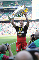 Owen Farrell of Saracens lifts the trophy after winning the Aviva Premiership Rugby Final between Saracens and Exeter Chiefs at Twickenham Stadium on Saturday 28th May 2016 (Photo: Rob Munro/Stewart Communications)