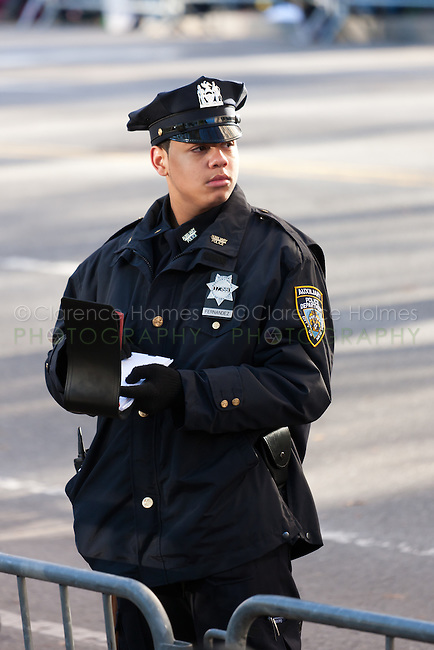 NEW YORK - NOVEMBER 24:  A NYPD Auxilliary Police officer takes notes while on duty at the annual Macy's Thanksgiving Day Parade on Thursday, November 24, 2011.