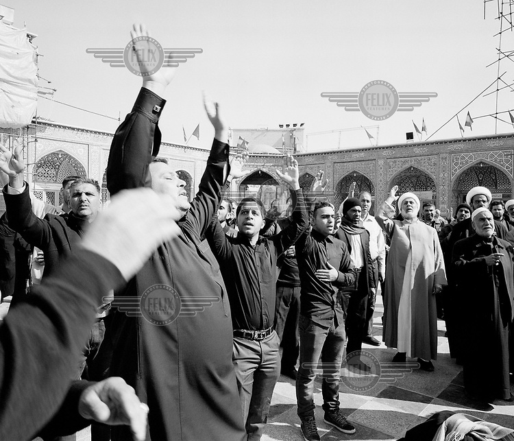 Shia pilgrims pray beneath the Fatima Masumeh Shrine. Thought to date from the Seventh Century CE, the major works were constructed in the Seventeenth and Eighteenth Centuries.