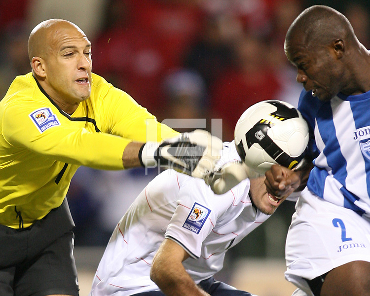 Tim Howard #1 of USA punches the ball onto Osman Chavez #2 of Honduras during a 2010 World Cup qualifier at Soldier Field on June 6 2009, in Chicago, Illinois. USA won 2-1.