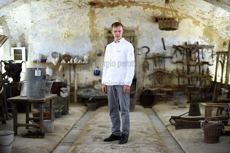 Taigo Lepik, the Chef to the Estonian President Toomas Hendrik Ilves, poses for a portrait in the Cascina Colombara during the annual meeting of the Club des Chefs des Chefs in Livorno Ferraris, Vercelli, Italy, July 18, 2015.<br /> The Club des Chefs des Chefs, which is seen as the world's most exclusive gastronomic society, has extremely strict membership criteria: to be accepted into this highly elite club, you need to be the current personal chef of a head of state. If he or she does not have a personal chef, members can be the executive chef of the venue that hosts official State receptions. One of the society's primary purposes is to promote major culinary traditions and to protect the origins of each national cuisine. The Club des Chefs des Chefs also aims to develop friendship and cooperation between its members, who have similar responsibilities in their respective countries. <br /> The annual meeting of the Club has been hosted this year in the production site of the Italian rice company called Riso Acquerello. <br /> © Giorgio Perottino