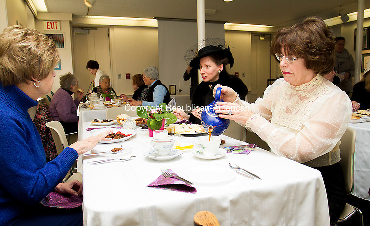 WOODBURY, CT - 03 JANUARY 2016 - 010316JW01.jpg -- Margaret McQuillan of Southbury pours herself some tea while Judy-Jo Barbash of Oxford and Marissa Jacovich of Middlebury chat during the Woodbury Library's Tea time viewing of Downton Abbey, last episode of Season 5 before the Sunday night Season 6 premier of the popular PBS series about a regal  Bristish family in the early 20th century.    Jonathan Wilcox Republican-American