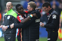 Max Gradel of Bournemouth celebrates scoring the opening goal with Manager Eddie Howe during the Barclays Premier League match between AFC Bournemouth and Swansea City played at The Vitality Stadium, Bournemouth on March 11th 2016