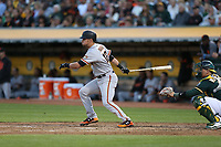 OAKLAND, CA - AUGUST 1:  Joe Panik #12 of the San Francisco Giants bats against the Oakland Athletics during the game at the Oakland Coliseum on Tuesday, August 1, 2017 in Oakland, California. (Photo by Brad Mangin)