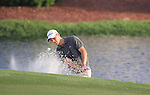 Martin Kaymer chips out of a bunker and onto the par3 17th green during Day 2 of the Dubai World Championship, Earth Course, Jumeirah Golf Estates, Dubai, 26th November 2010..(Picture Eoin Clarke/www.golffile.ie)