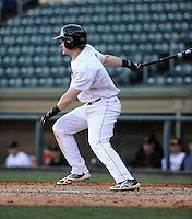 Second baseman Ian Happ (5) of the Cincinnati Bearcats in a game against the Western Carolina Catamounts on Sunday, February 24, 2013, at Fluor Field in Greenville, South Carolina. Cincinnati won in 10 innings, 7-6. (Tom Priddy/Four Seam Images)