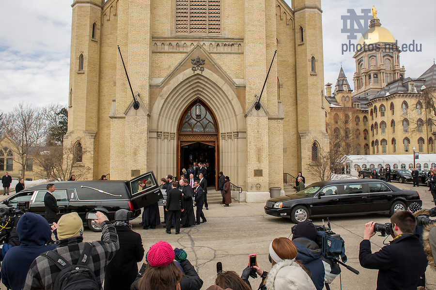 Mar. 4, 2015; The casket of  President Emeritus Rev. Theodore M. Hesburgh, C.S.C., is carried out the Basilica of the Sacred Heart following the funeral Mass.  (Photo by Barbara Johnston/University of Notre Dame)