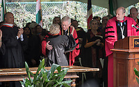 "Professor A.H. ""Woody"" Studenmund accepts a posthumous honorary degree for his son, U.S. Army Special Forces Staff Sgt. Scott Studenmund, from Trustee Rosemary Simmons '53 and President Jonathan Veitch at Occidental College's 133rd Commencement at the Remsen Bird Hillside Theater, on Sunday, May 17, 2015.<br /> (Photo by Marc Campos, Occidental College Photographer)"