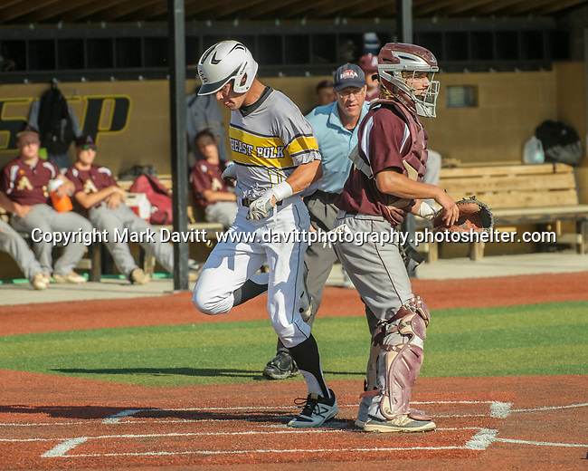 Southeast Polk and Ankeny met for a double header at SEP June 21. SEP prevailed twice, 2-0 and 8-1. SEP's Joe Bagley crosses home plate.