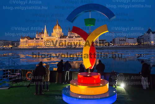 Logo of the Budapest Olympic candidacy is seen as ice blocks float on the surface of river Danube in front of the houses of the Parliament in Budapest, Hungary on January 08, 2017. ATTILA VOLGYI