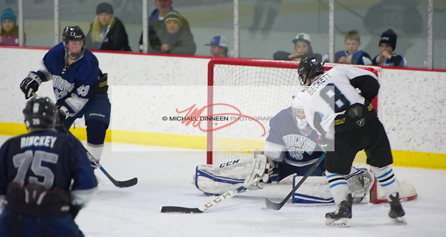 Chugiak's Andrew Beckett sets up to score on Eagle River's Ryan Gray during the Mustang's 5-2 win at the McDonald Center Saturday, January 28, 2017.   Lookin on are Chugiak's Logan Dudinsky and Ben Rinckey. Photo for the Star by Michael Dinneen