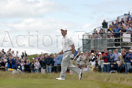 18 July 2004: French golfer THOMAS LEVET (FRA) celebrates his eagle chip at the 4th during his final round of 72 in The Open Championship, played at Royal Troon, Scotland. Levet finished in joint fifth place on 279 Photo: Glyn Kirk/Action Plus...golf golfers 040718 crowd gallery winning joy celebrate celebration celebrations british