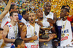 "France`s basketball team players Nando De Colo, Tony Parker, Boris Diaw, Alexis Ajinca, Mickael Gelabale, Florent Pietrus, Johan Petro and Antoine Diot celebrate with the trophy after European championship ""Eurobasket 2013""  final game between France and Lithuania in Stozice Arena in Ljubljana, Slovenia, on September 22. 2013. (credit: Pedja Milosavljevic  / thepedja@gmail.com / +381641260959)"