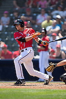 Kelby Tomlinson (1) of the Richmond Flying Squirrels follows through on his swing against the Bowie Baysox at The Diamond on May 24, 2015 in Richmond, Virginia.  The Flying Squirrels defeated the Baysox 5-2.  (Brian Westerholt/Four Seam Images)