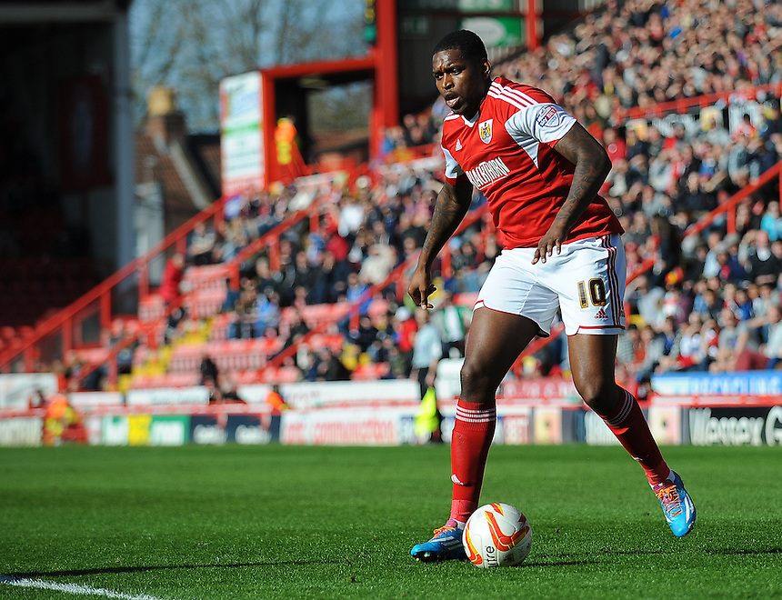 Bristol City's Jay Emmanuel-Thomas in action during todays match  <br /> <br /> Photo by Kevin Barnes/CameraSport<br /> <br /> Football - The Football League Sky Bet League One - Bristol City v Swindon Town - Saturday 15th March 2014 - Ashton Gate - Bristol<br /> <br /> &copy; CameraSport - 43 Linden Ave. Countesthorpe. Leicester. England. LE8 5PG - Tel: +44 (0) 116 277 4147 - admin@camerasport.com - www.camerasport.com