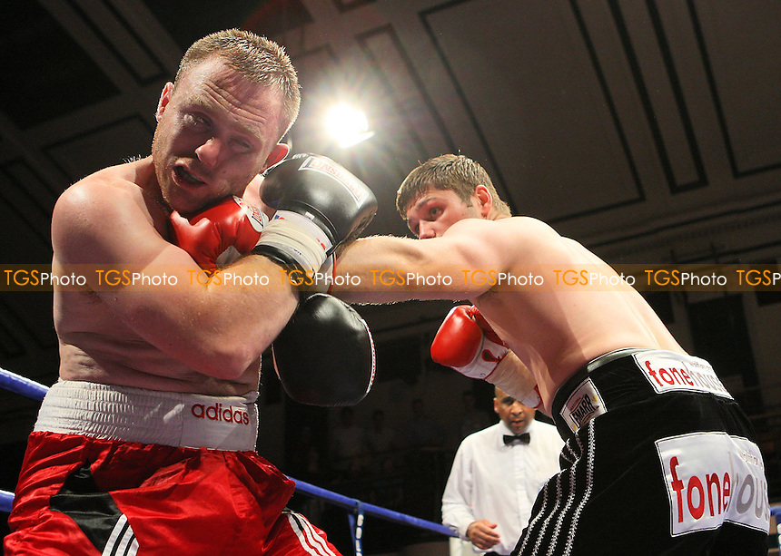 George Hillyard (Canning Town, black shorts) defeats Danny Goode (New Milton, red shorts) in a Light-Middleweight contest at York Hall Bethnal Green, promoted by Hennessy Sports - 27/06/08 - MANDATORY CREDIT: Gavin Ellis/TGSPHOTO - Self billing applies where appropriate - Tel: 0845 094 6026.