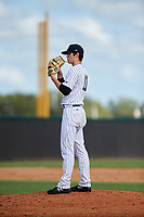 New York Yankees pitcher Nolan Martinez (11) looks in for the sign during an Instructional League game against the Baltimore Orioles September 23, 2017 at the Yankees Minor League Complex in Tampa, Florida.  (Mike Janes/Four Seam Images)