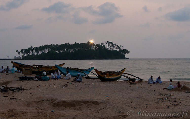 Barberyn (Beruwala) Light comes on at dusk as fishermen relax at day's end -Beruwala, Sri Lanka
