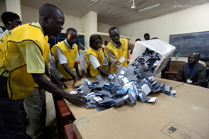 Saturday 15 january 2011 - Juba, Sudan - Poll workers open the ballot boxes after the closing of University polling station in Juba, South Sudan. South Sudan's polling centres closed their doors on Saturday after a week-long vote on independence from the north that could end a vicious cycle of civil war with the creation of the world's newest state. Photo credit: Benedicte Desrus