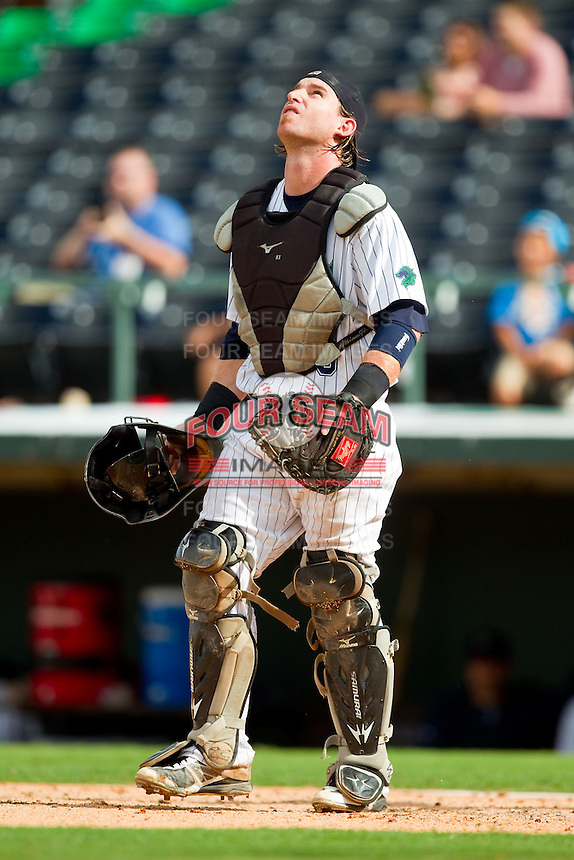 Charlotte Knights catcher Bryan Anderson (33) on defense against the Durham Bulls at Knights Stadium on August 18, 2013 in Fort Mill, South Carolina.  The Bulls defeated the Knights 5-1 in Game Two of a double-header.  (Brian Westerholt/Four Seam Images)