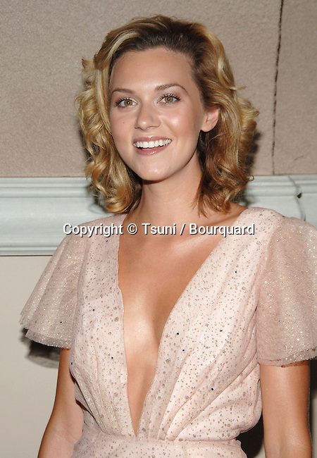 Hilarie Burton  arriving at the  CW television Critic Assocoation Summer Party at the Ritz Carlton Pasadena Los Angeles. July 17, 2006.<br /> eye contact<br /> headshot<br /> smile