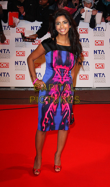KONNIE HUQ.The 15th National Television Awards held at the O2 Arena, London, England. .January 20th, 2010 .NTA NTAs full length blue black pink pattern print dress hands on hips .CAP/ROS.©Steve Ross/Capital Pictures.