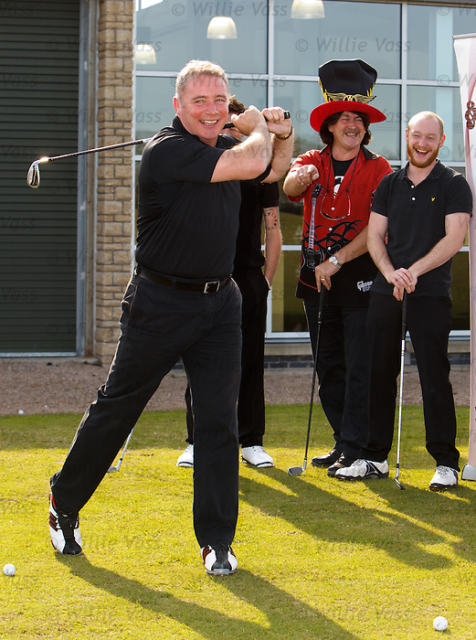 Ally McCoist slices a shot into a farmer's field at Mearns Castle egged on by Donald MacLeod (chairman of Nordof Robbins) and Ben Johnston (Biffy Clyro) during a fundraiser for charity