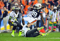 Jan 10, 2011; Glendale, AZ, USA; Auburn Tigers wide receiver Darvin Adams (89) is tackled by Oregon Ducks safety John Boyett (20) during the first half of the 2011 BCS National Championship game at University of Phoenix Stadium.  Mandatory Credit: Mark J. Rebilas-